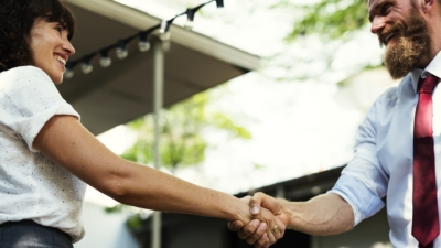 photo of people shaking hands, becoming affiliates