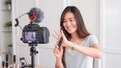 photo of young woman using video marketing to promote her products