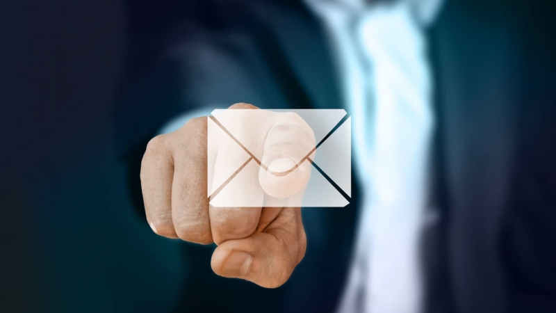 photo of man pushing email icon, increase email open rates