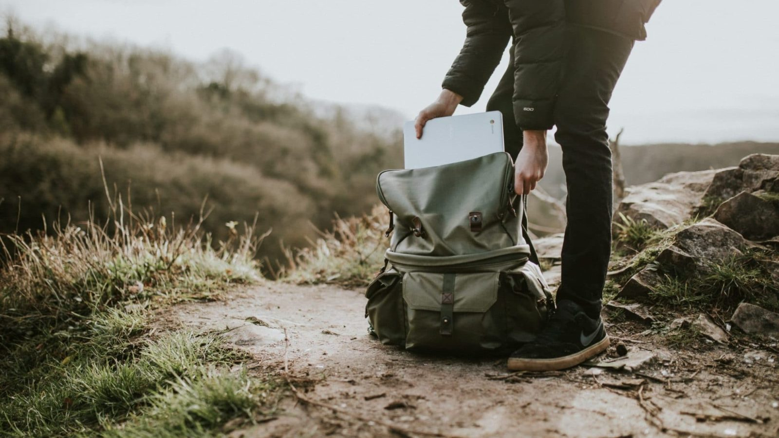 image of person hiking with laptop