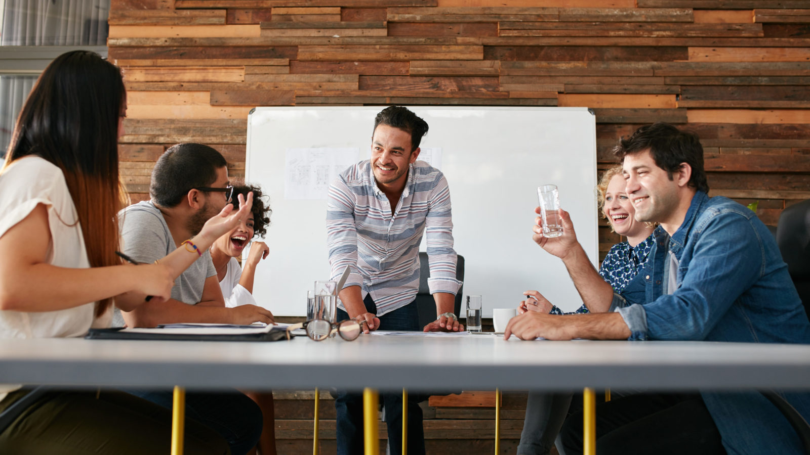 group of people at an agency sitting down at a table talking