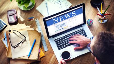 image of news website on laptop