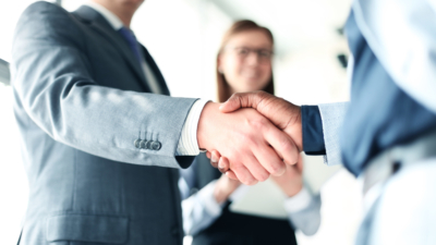 photo of corporate business people shaking hands