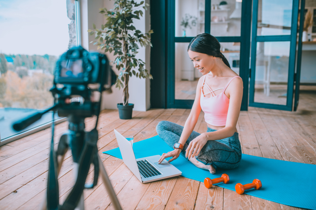 photo of a fitness blogger filming an exercise video