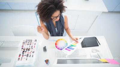 photo of designer looking at color palette at desk